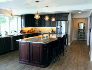 Dark wood cabinets wrap the kitchen with a large center island