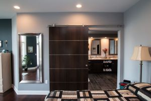 Dark wood barn door with horizontal chrome accents