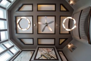 Wood trimmed coffered ceiling with recessed lighting