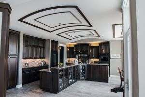 Dark wood cabinet kitchen with curved ceilings
