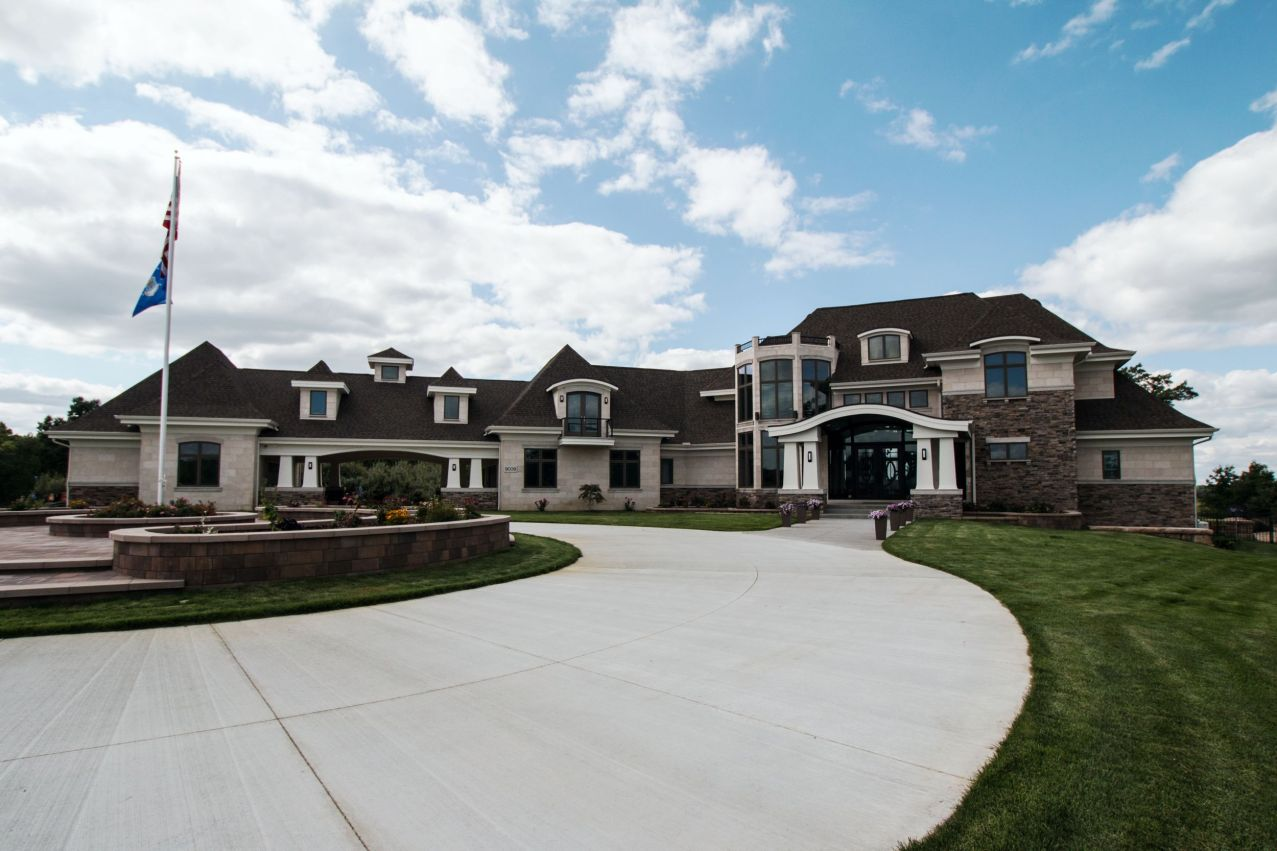 Front view of custom home with circle drive