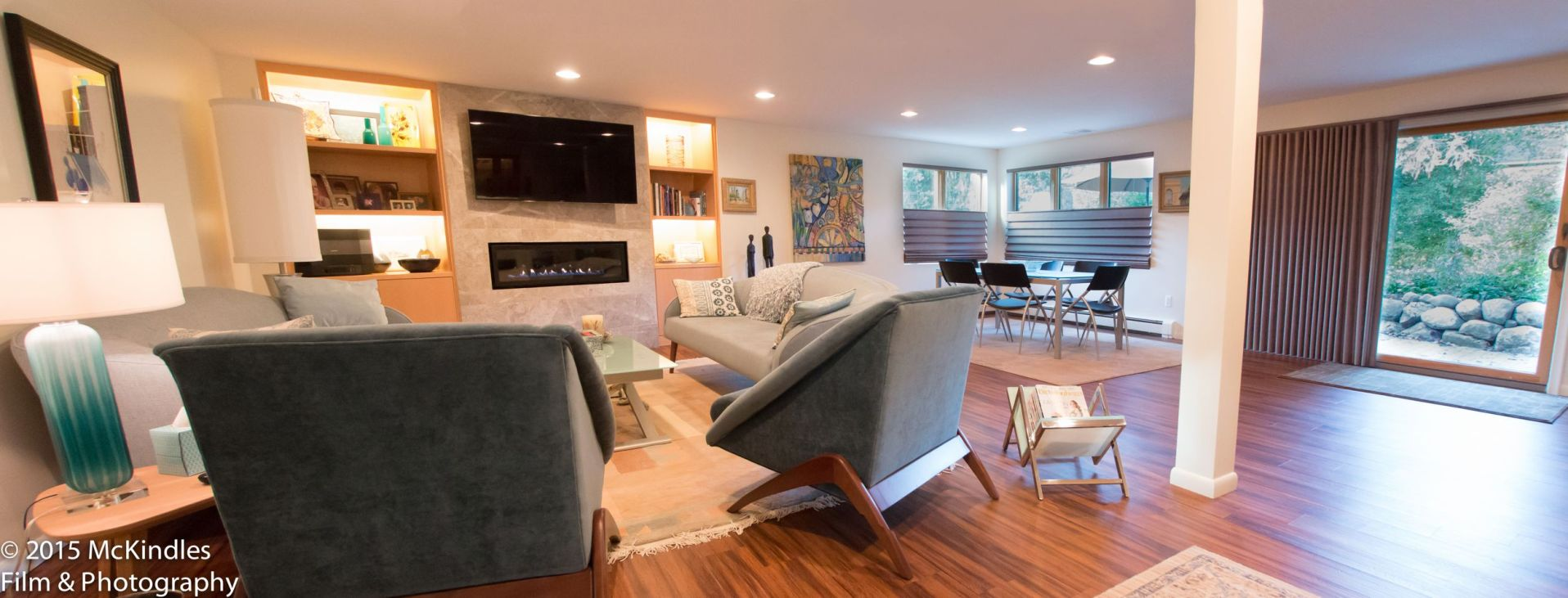 Panorama view of mid-century modern lower level living area