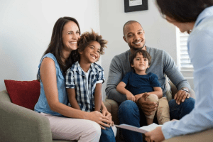 family meets with a therapist during family therapy in Rockville, MD at Montgomery County Counseling Center