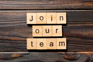 scrabble letters saying join our team. Montgomery county counseling center is hiring therapists in rockville, MD