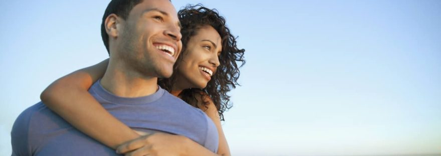 happy biracial couple on beach, couples counseling