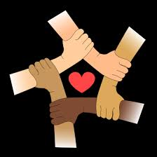 interlocking hands of various skin colors denoting allyship in antiracism