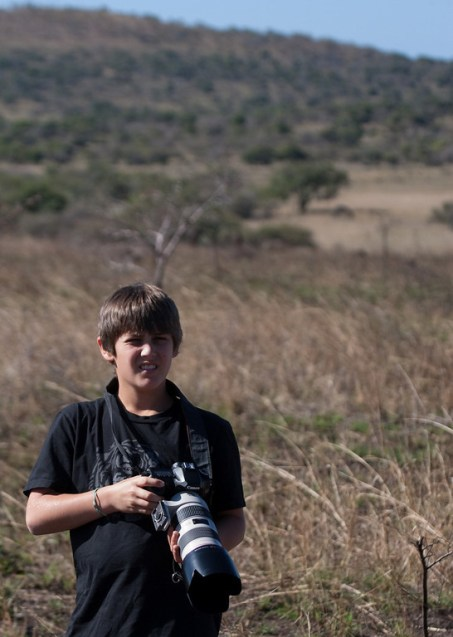 mc with camera in bush