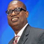 Black Man smiling with glasses