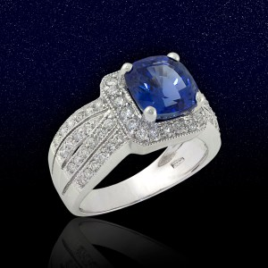 white gold ring with sapphire center and diamond side stones