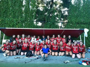 Caroline Lucas-Conwell (6) and Jessica Kras (22) pose with the rest of McGill's women's lacrosse team. (Photo courtesy McGill women's lacrosse)