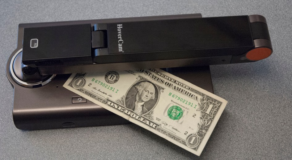 Camera in closed position with dollar for scale