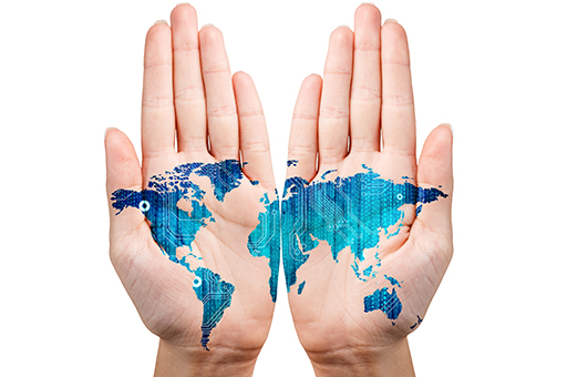 two hands, palms facing up, with map of the world painted on them