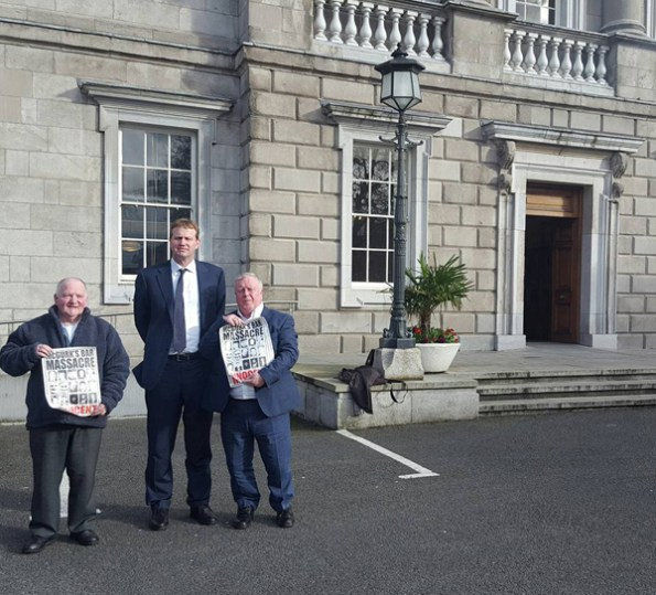 Justice and Equality Spokesperson, Jim O'Callaghan (centre), meets with McGurk's Bar family members, Frank McLaughlin (left) and Robert McClenaghan (right)