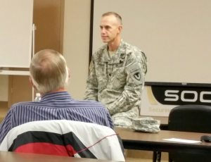 Heidi Bunch Lt. Col. Gregory Gibbons answers questions at the Hawthorne Army Depot Town Hall meeting.