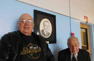 Sheri Samson Gary Funk (left) stands next to his father's rendering that he created, as Arlo Funk, his father, smiles approvingly.