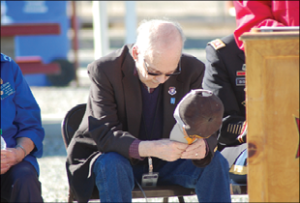 Heidi Bunch photos Mineral County Commissioner Paul MacBeth bows his head in prayer during the Veterans Day ceremony on Friday.