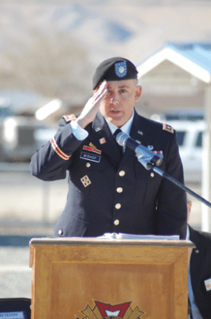 Lt Col Scott Bishop salutes Mineral County vets in attendance at Veterans Memorial Park.