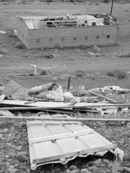 Winds damage Walker Lake building, knock down power poles