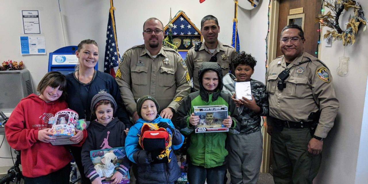 Local Children Spend a Day Shopping and Dining with Cops