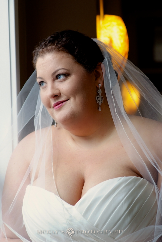 plus sized Bride on her wedding day by wedding photographer in Rochester