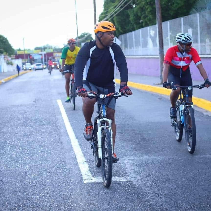 PNP General Secretary rides his fancy bicycle round town