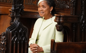 Why did Meghan Markle's mother sit in the second row during the royal wedding?