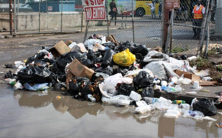 Who is responsible for cleaning-up Montego Bay's Street Garbage? (Photo property of Mckoy's News)
