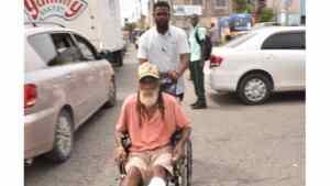 Richard Vernon Helps A Wheel Chair Man