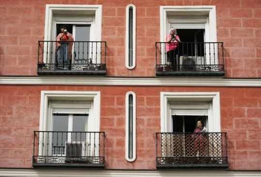 Spaniards in lockdown bang pots in protest against former king