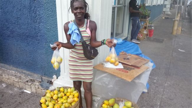 On MoBay streets, Delcita is happy and content in Covid times