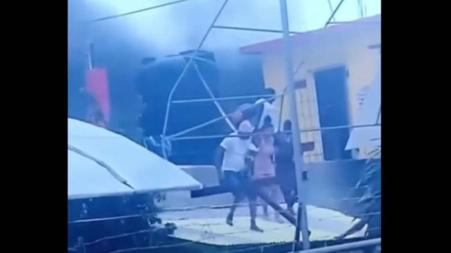 Woman and Baby Rescused from Burning Building in Flanker, St. James – Video