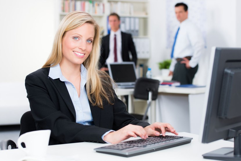 business women typing on computer