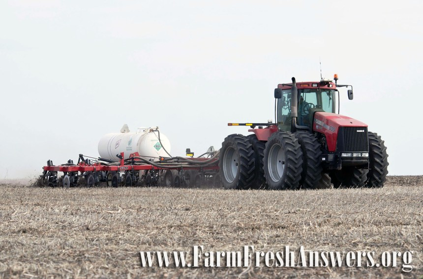 "White ""nurse tanks"" are used to apply a form of nitrogen fertilizer called anhydrous ammonia to fields. Nitrogen is an essential nutrient for plants and anhydrous ammonia has the highest nitrogen content of any commercial fertilizer. Photo courtesy of Illinois Farm Bureau."