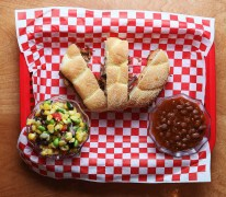 RoRoBBQ's pulled pork sandwich with a side of baked beans and succotash.