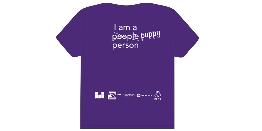 """T-Shirt design (back) says """"I am a people person"""" with the word people crossed out and puppy written over top. Logos are on the bottom of the shirt."""