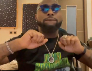 "Davido Spotted In Late Ghanaian Artist ""Terry Bonchaka"" Shirt (Video)"