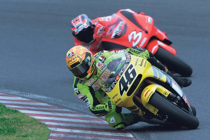 Rossi battling on track with Max Biaggi
