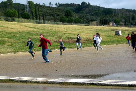 French schoolkids race the ancient 200m track.