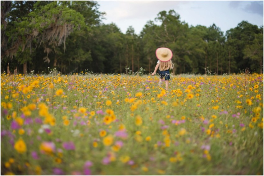 little girl running in the flowers | jacksonville children photographer