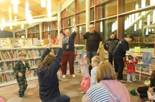 Children and adults stretching at Olney Library