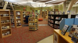 Aisle with shelves of books on either side
