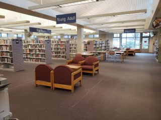 Comfy chairs where the wire book racks used to be