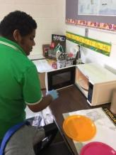 Student Working with Microwave