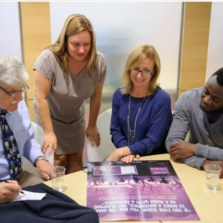 Lt. Gen (ret) Roméo Dallaire, co-author Jessica Dee Humphreys, Michaela Cornell, Kids Can Press Communications Strategist and Michel Chikwanine look at the poster for CHILD SOLDIER in the Toronto Public Library green room.