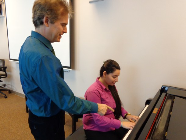 Professor Behr instructs a student during his Piano Skills class. Photo by Claire Leaden.