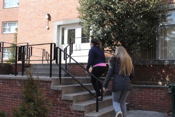 Above, students enter Jasper Hall, one of the two dorms without fully functioning fire alarm systems for over two weeks. Photo by Lindsey Burns.