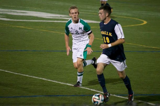 Alex Shackley, left, chases down La Salle Explorer George Breslin. Photo by Kevin Fuhrmann.