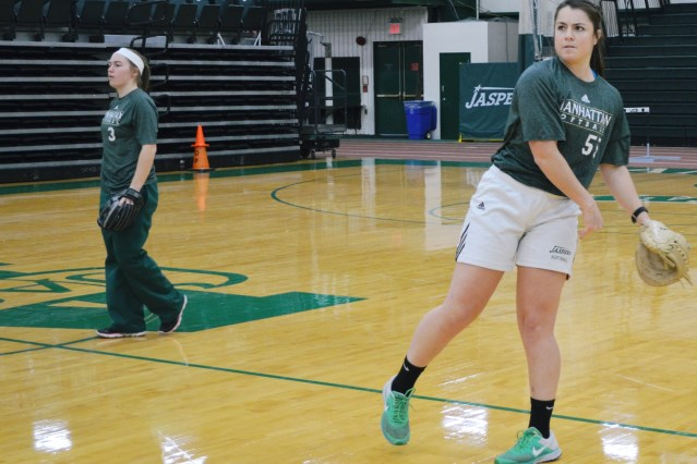 Infielder Rachael Mumma, left, and MAAC Preseason Player of the Year Elena Bowman, right, practicing in Draddy Gym in February to prep for the season. Photo taken by Victoria Hernandez.