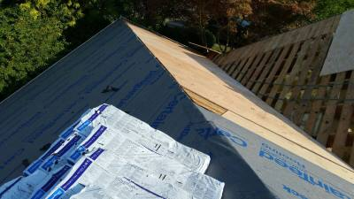 Installing synthetic felt over half inch CDX Plywood