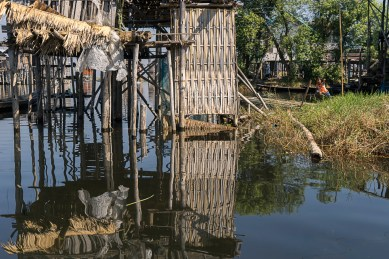 Pictures of Stilt House Reflections on Inle Lake Myanmar Burma with TCS World Travel Uncharted Myanmar trip by mcmessner Mary Catherine Messner